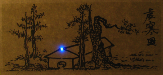 LED placed on an art work in which the closed ciruit is made using conducting ink